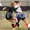 Kyle Bursaw – kbursaw@daily-chronicle.com<br /> <br /> Genoa-Kingston's Alana Dean passes away from Harvard's Grace Iftner in the first half of the game at Genoa-Kingston high school on Tuesday, April 5, 2011.