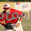 Rob Winner – rwinner@daily-chronicle.com<br /> <br /> After fielding a ground ball, DeKalb County first baseman Jacob Lueneburg trots to first for an out during the second inning in Sycamore, Ill. on Thursday, July 21, 2011.