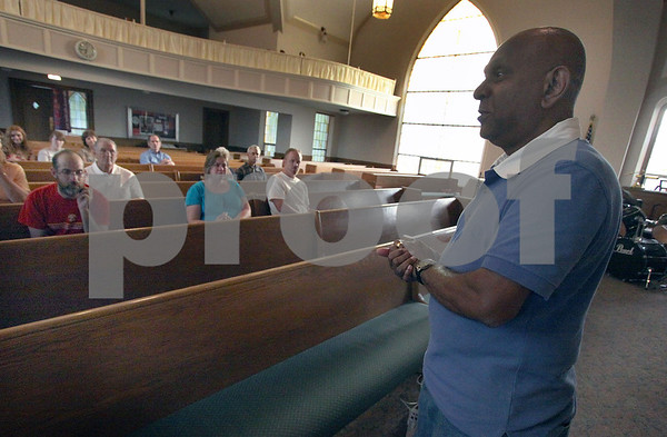 Wendy Kemp - For The Daily Chronicle<br /> <br /> Dan Chetti, an American Baptist missionary (right), talks about his ministry in Lebanon at First Baptist Church in DeKalb on Wednesday.<br /> DeKalb 7/6/11