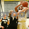 Rob Winner – rwinner@shawmedia.com<br /> <br /> Kaneland's Ashley Prost (left) fouls Sycamore's Olyvia Rand (34) during the third quarter in Sycamore on Friday, Dec. 9, 2011.
