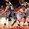 Kyle Bursaw – kbursaw@daily-chronicle.com<br /> <br /> Northern Illinois' Marke Freeman reacts to losing the ball in the second half, while Akron's Natasha Williams (11) tries to pick up the loose ball. The Huskies fell to the Zips 72-43 in DeKalb, Ill. onSaturday, Feb. 5, 2011.