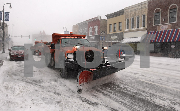 Kyle Bursaw – kbursaw@daily-chronicle.com<br /> <br /> A pair of plows clear off Lincoln Highway in downtown DeKalb on Tuesday, Feb. 1, 2011.