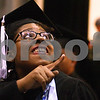 Kyle Bursaw – kbursaw@daily-chronicle.com<br /> <br /> A graduating NIU student points to someone she knows in the audience while entering the floor of the Convocation Center for the 9 a.m. ceremony in DeKalb, Ill. on Saturday, May 14, 2011.