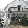 Firefighters work Tuesday morning to remove aluminum siding from 414 Prospect St. in DeKalb after the home's electrical meter base caught fire and spread to the house. DeKalb Fire Chief Bruce Harrison said no one was injured during the fire.<br /> <br /> Caitlin Mullen - cmullen@daily-chronicle.com