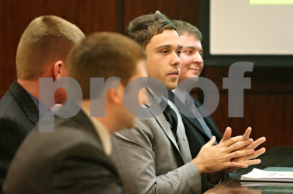 Rob Winner – rwinner@shawmedia.com<br /> <br /> Alan Hurt answers a question during his team's presentation at the first annual Northern Illinois University Social Venture Competition on Thursday night in DeKalb. The team, Light Up Africa, won the competition and received $10,000 from Dennis Barsema to launch their company.