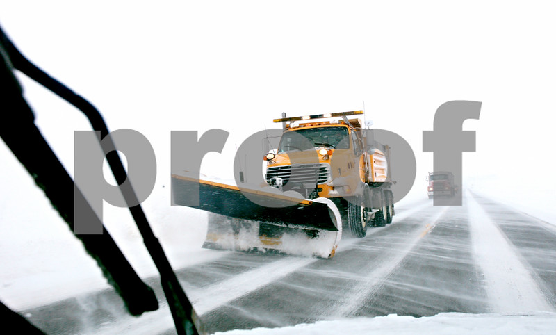 Rob Winner – rwinner@daily-chronicle.com<br /> <br /> A snow plow truck clears Perry Road while heading east in Pierce Township on Tuesday afternoon.