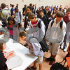 Kyle Bursaw – kbursaw@shawmedia.com<br /> <br /> DeKalb High School students wait in line to pick up their schedules in the school's fieldhouse on Tuesday, Sept. 6, 2011, the first day of school.