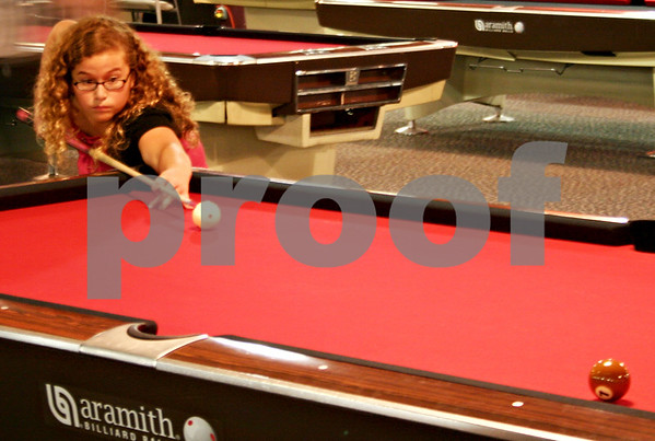 Billiards player April Larson, 11, of Bloomington, Minn, lines up her shot during a semi-final match of the 23rd Annual Junior National 9-Ball Championships Tournament at the Huskie Den. She would win second place overall for her age division.<br /> By ANDREW MITCHELL — amitchell@daily-chronicle.com
