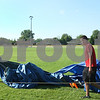 Kyle Bursaw – kbursaw@daily-chronicle.com<br /> <br /> Liners staff members Dane Pritchard (left) and Adrian Gonzales haul a tarp away from the area where a pavilion will be put in at Sycamore Park, on Tuesday, May 31, 2011.