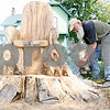 Rob Winner – rwinner@shawmedia.com<br /> <br /> Sycamore resident and sculptor Lynden Bute uses a chain saw for a make-over of the tree trunk chair located on the 600 block of Somonauk Street in Sycamore on Tuesday, Sept. 20, 2011.