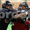 Kyle Bursaw – kbursaw@shawmedia.com<br /> <br /> Northern Illinois wide receiver DeMarcus Grady tries to strip the ball from fellow wide receiver Willie Clark (right) while running a drill during practice at the DeKalb Recreation Center on Wednesday, Dec. 14, 2011.