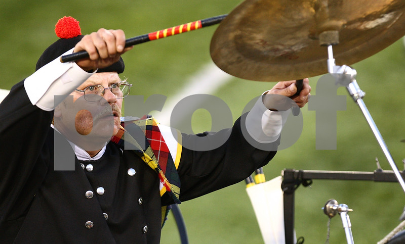 Kyle Bursaw – kbursaw@daily-chronicle.com<br /> <br /> Jeff Hart plays reaches up to play a cymbal for the Kilties from Racine, Wis. as they perform at Huskie Stadium during a drum and bugle competition on Saturday, July 30, 2011.