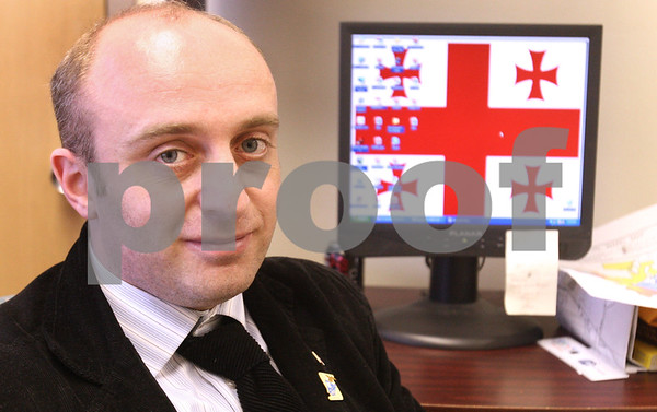 Kyle Bursaw – kbursaw@daily-chronicle.com<br /> <br /> Kakhaberi Gvantseladze has the Republic of Georgia flag as his computer wallpaper in his office in DeKalb city hall. Gvantselasze is in DeKalb as part of the Legislative Fellows program, coming from Kutaisi in the Republic of Georgia.<br /> <br /> Tuesday, April 12, 2011.
