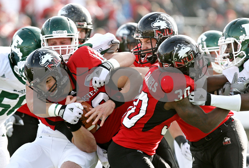 Rob Winner – rwinner@shawmedia.com<br /> <br /> Northern Illinois quarterback Chandler Harnish (12) is tackled after a six yard gain during the second quarter in DeKalb, Ill., on Friday, Nov. 25, 2011. Northern Illinois defeated Eastern Michigan, 18-12.