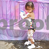 Kyle Bursaw – kbursaw@daily-chronicle.com<br /> <br /> Audrey Hernandez, 2, plays with washable paint in a spray bottle while covered in shaving cream outside the DeKalb Public Library during the Silly Summer Fun event on Wednesday, Aug. 3, 2011.
