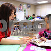 Kyle Bursaw – kbursaw@shawmedia.com<br /> <br /> Lissette Jacobson, a first grade teacher in a bilingual classroom at Cortland Elementary, works one-on-one with Sophia Cintora while assessing her students fluency skills in both Spanish and English on Thursday, Nov. 17, 2011.