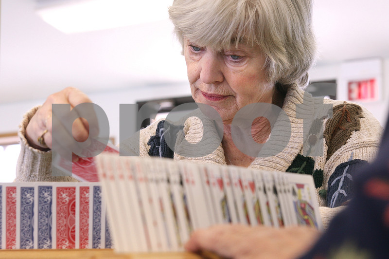 Kyle Bursaw – kbursaw@daily-chronicle.com<br /> <br /> Carol Jacobsen arranges her cards while playing pinochle at the Sycamore Senior Activity Center on Friday, Jan. 21, 2011.