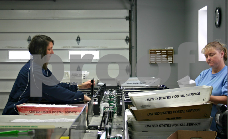 Kim Colness (right) and Susan Mizgalski check mail barcodes and sort letters into trays at Provident Direct in downtown Sycamore. The business is expanding and its mail-sorting equipment will soon be moved across the street to recently-purchased office space at 216 South California St.<br /> <br /> By NICOLE WESKERNA - nweskerna@shawmedia.com