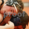 Rob Winner – rwinner@shawmedia.com<br /> <br /> DeKalb's Dylan Vaughn-Low (top) holds Prospect's Jason Schwietert to the mat during their 160-pound match in the Don Flavin Tournament on Friday, Dec. 30, 2011, in DeKalb, Ill.