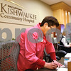 Kyle Bursaw – kbursaw@shawmedia.com<br /> <br /> Judy Letzter, a volunteer at Kishwaukee Community Hospital, fills out an infant sticker to place on a the stroller on Thursday, Dec. 15, 2011.