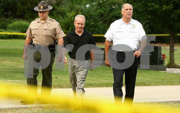 Kyle Bursaw – kbursaw@daily-chronicle.com<br /> <br /> From left Master Sergeant Isaiah Vega, DeKalb County State's Attorney Clay Campbell and Sycamore Police Chief Don Thomas head to the edge of the taped off area in Elmwood Cemetery on Wednesday, July 27, 2011.