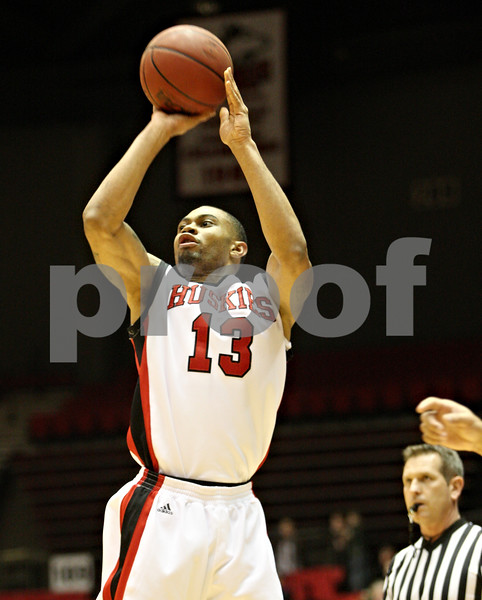 Rob Winner – rwinner@daily-chronicle.com<br /> <br /> Northern Illinois guard Xavier Silas puts up a three-pointer during the first half in DeKalb, Ill., against Akron on Wednesday, Jan. 26, 2011.