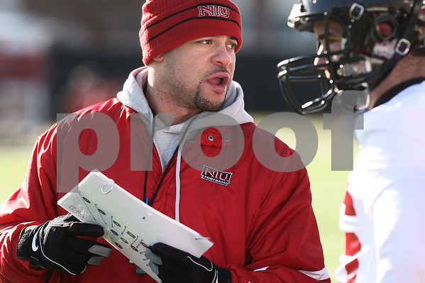 Kyle Bursaw – kbursaw@daily-chronicle.com<br /> <br /> Running backs coach Eddie Faulkner talks to players on the sidelines during practice at Huskie Stadium on Thursday, March 24, 2011.