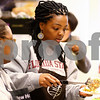 Kyle Bursaw – kbursaw@shawmedia.com<br /> <br /> April Aaron plates some food for someone getting a Thanksgiving day meal at New Hope Missionary Baptist Church in DeKalb, Ill. on Thursday, Nov. 24, 2011.