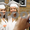 Rob Winner – rwinner@daily-chronicle.com<br /> <br /> Kristin Groesch (left) and Samantha Hisaw pose for a photograph before entering the gymnasium during the Sandwich Community High School commencement ceremony on Sunday in Sandwich.