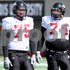 Kyle Bursaw – kbursaw@daily-chronicle.com<br /> <br /> Offensive linemen Tyler Loos (75) and Adam Kiel (74) wait their turn at a drill during practice at Huskie Stadium on Saturday, March 26, 2011.