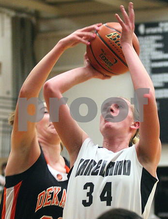Kyle Bursaw – kbursaw@shawmedia.com<br /> <br /> DeKalb's Emily Bemis blocks the shot of Kaneland's Kelly Evers during the second quarter of their game at Kaneland High School on Tuesday, Dec. 13, 2011.