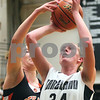 Kyle Bursaw – kbursaw@shawmedia.com<br /> <br /> DeKalb's Emily Bemis blocks the shot of Kaneland's Kelly Evers during the second quarter of their game at Kaneland High School on Tuesday, Dec. 13, 2011.