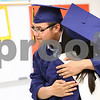 Kyle Bursaw – kbursaw@daily-chronicle.com<br /> <br /> Quan Nguyen hugs fellow Hiawatha senior Diana Ascencio in a classroom before Hiawatha's graduation ceremony on Friday, May 27, 2011.