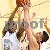 Kyle Bursaw – kbursaw@shawmedia.com<br /> <br /> Kaneland's Thomas Williams and Morris' Danny Friend both grab for a rebound in the first quarter of their game in the Plano Christmas Classic in Plano, Ill. on Tuesday, Dec. 27, 2011. The Knights defeated the Redskins 50-44.