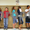 Kyle Bursaw – kbursaw@shawmedia.com<br /> <br /> Huntley Middle School sixth graders line up by lockers as they wait to rotate classrooms on the first day of school on Tuesday, Sept. 6, 2011.