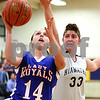 Kyle Bursaw – kbursaw@shawmedia.com<br /> <br /> Hinckley-Big Rock's Kaitlin Phillips shoots in front of Hiawatha's Randi Maynard during the first quarter of their game in Kirkland, Ill. on Monday, Dec. 12, 2011