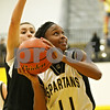 Rob Winner – rwinner@shawmedia.com<br /> <br /> Sycamore's Lake Kwaza (11) puts up two during the third quarter in Sycamore on Friday, Dec. 9, 2011.