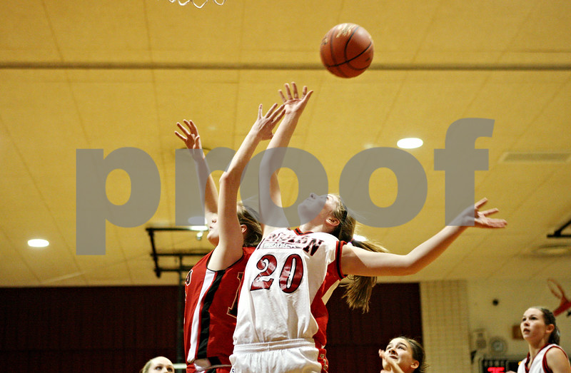 Rob Winner – rwinner@daily-chronicle.com<br /> <br /> Indian Creek's Kate Thuestad (20) goes up for a rebound underneath the Leland-Earlville basket during the second quarter of a game on Thursday, January 6, 2011.
