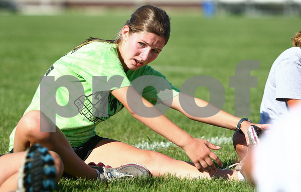 Kyle Bursaw – kbursaw@daily-chronicle.com<br /> <br /> Renae Kurpius, a junior at Genoa-Kingston stretches after running sprints during cross country practice on Thursday, Aug. 11, 2011.