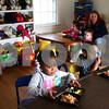 Kyle Bursaw – kbursaw@shawmedia.com<br /> <br /> Amirah Newsom (left), 3, and Caden McCoy (front right), 2, both start by eating the fruit portion of their lunch at Diana Hodge's daycare in DeKalb, Ill. on Thursday, Dec. 8, 2011. Hodge's daycare is part of the Child and Adult Care Food Program through Community Coordinated Child Care.