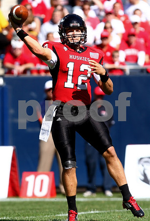 Kyle Bursaw – kbursaw@shawmedia.com<br /> <br /> Northern Illinois quarterback Chandler Harnish (12) throws in the first quarter of the game against Wisconsin at Soldier Field in Chicago, Ill. on Saturday, September 17, 2011. Wisconsin defeated Northern Illinois 49-7.