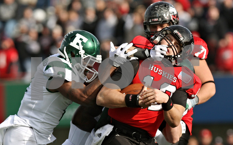 Rob Winner – rwinner@shawmedia.com<br /> <br /> Northern Illinois quarterback Chandler Harnish (12) is tackled by Eastern Michigan linebacker Colin Weingrad after a seven yard gain during the second quarter in DeKalb, Ill., on Friday, Nov. 25, 2011. Weingrad was not flagged for a face mask penalty on the play. Northern Illinois defeated Eastern Michigan, 18-12.