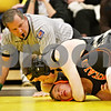 Rob Winner – rwinner@daily-chronicle.com<br /> <br /> Sycamore's Kyle Culton (top) holds down DeKalb's Dalton Watie in the 160-pound match on Thursday, Jan. 13, 2011 in Sycamore, Ill. Culton would go on to win the match for Sycamore.