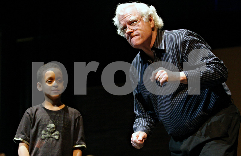 Rob Winner – rwinner@daily-chronicle.com<br /> <br /> Nigel Dyson (left), 9, who is playing Pinocchio, and George Schippits, who is playing Geppetto, rehearse a scene from Disney's My Son Pinocchio with fellow cast members of the Children's Community Theatre on Monday night at the O'Connell Theatre in the Stevens Building at Northern Illinois University in DeKalb.