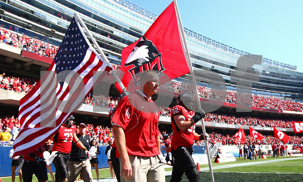 Kyle Bursaw – kbursaw@shawmedia.com<br /> <br /> Northern Illinois head coach Dave Doeren and his players walk onto Soldier Field for their game against Wisconsin in Chicago, Ill. on Saturday, September 17, 2011. Wisconsin defeated Northern Illinois 49-7.