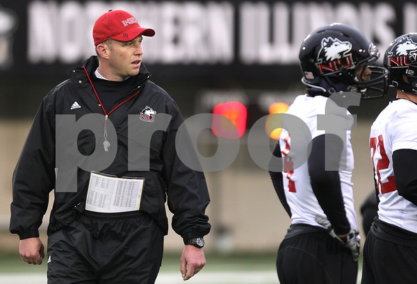 Kyle Bursaw – kbursaw@daily-chronicle.com<br /> <br /> Northern Illinois head coach Dave Doeren watches over practice at Huskie Stadium on Tuesday, March 22, 2011.