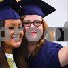Kyle Bursaw – kbursaw@daily-chronicle.com<br /> <br /> Diana Ascencio (left) and Laura Gee take a picture in their cap and gowns while waiting in a classroom to line up for Hiawatha's graduation ceremony on Friday, May 27, 2011.