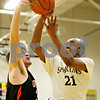 Rob Winner – rwinner@daily-chronicle.com<br /> <br /> DeKalb's Jake Jouris (left) is called for a foul on Sycamore's Rashaud Bomar (21) during the third quarter in Sycamore, Ill. on Friday, Feb. 25, 2011. DeKalb defeated Sycamore, 56-42.