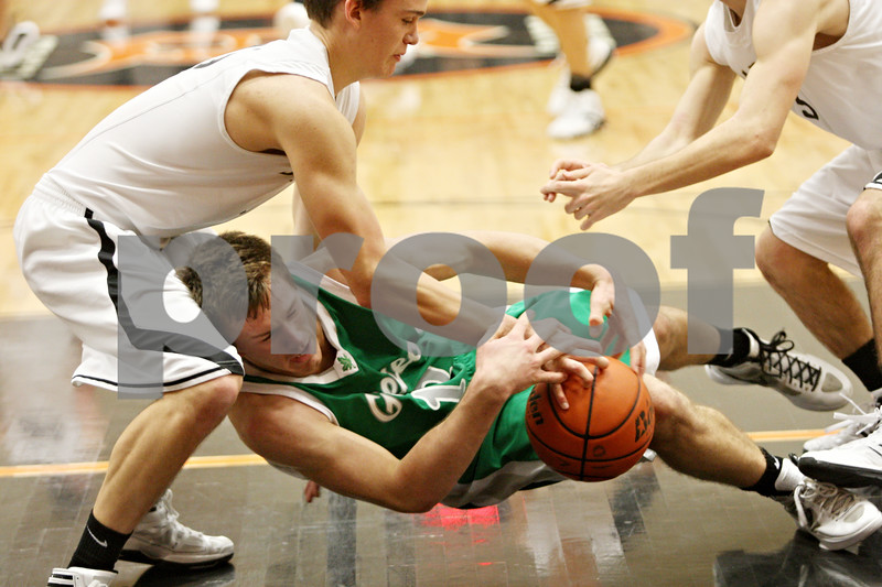 Rob Winner – rwinner@shawmedia.com<br /> <br /> Sycamore forward Devin Mottet (left) fouls Geneseo guard Landon Hoon during the fourth quarter in DeKalb, Ill., at the Chuck Dayton Tournament on Wednesday, Dec. 28, 2011. Geneseo defeated Sycamore, 31-26.