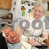 Rob Winner – rwinner@daily-chronicle.com<br /> <br /> John Shepherd, 44, receives a nebulizer treatment from his legal guardian Eileen Bosshart, 78, at Bosshart's home in Genoa, Ill. on Wednesday, May 4, 2011. Shepherd has cerebral palsy and profound mental retardation. Bosshart has been Shepherd's legal guardian for 26 years.